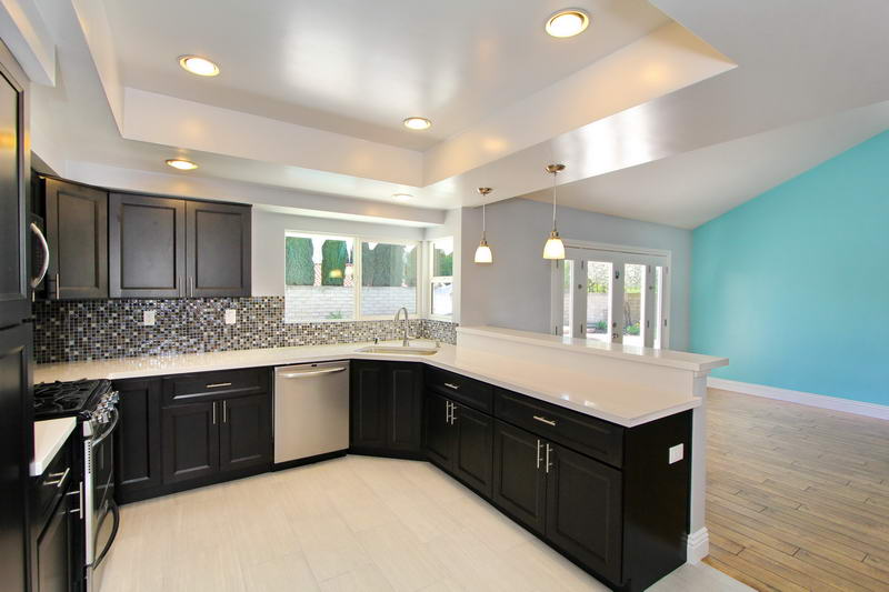 After Of The Kitchen Breakfast Bar Added New Stainless Steel Appliances Recessed Lighting Quartz Counter Top Cabinets